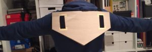 Over-sized Arduino-powered tilt switch - wearable, back view.
